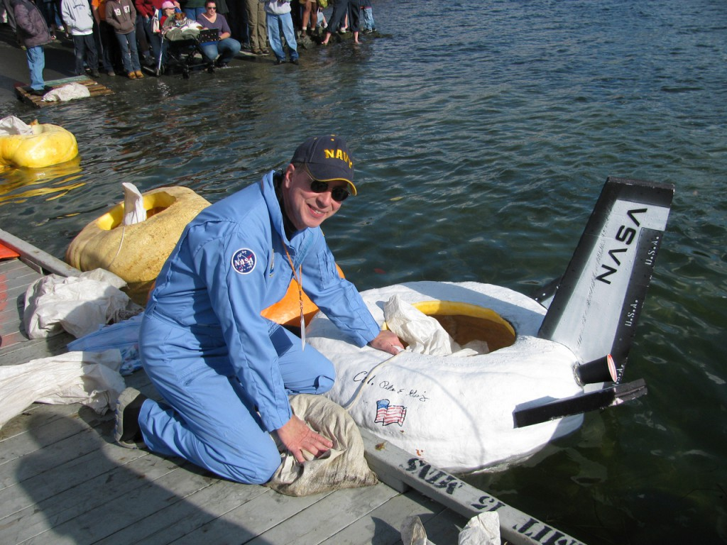 Peter Geiger's space shuttle pumpkin was the fastest on the water during the paddle division of the pumpkin regatta. &quotThat is the most stable pumpkin I've ever paddled,&quot Geiger, the editor of the Farmers Almanac, said about his white-painted 525-pound vessel. (Bangor Daily News/Abigail Curtis)