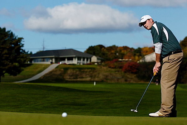 Husson University junior and co-captain Kevin Byrne putts to hole one during Monday morning's round of the North Atlantic Conference Golf Championship at Penobscot Valley Country Club in Orono. (Bangor Daily News/John Clarke Russ)