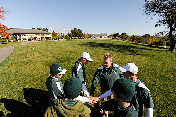 Husson University's golf team huddles before Monday morning's round of the North Atlantic Conference Golf Championship at Penobscot Valley Country Club in Orono. Clockwise from bottom left are junior Mike Hersey of Presque Isle, senior co-captian John Ellis of Belfast, Kevin Byrne of Winslow, Coach Ed Meo, sophomore Matt Loubier of Winslow and Ben Estabrook of Bangor. (Bangor Daily News/John Clarke Russ)