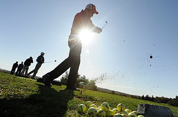 University of Maine-Farmington junior Rich Matthews of Portland gets in some driving practice before Monday morning's round of the North Atlantic Conference Golf Championship at Penobscot Valley Country Club in Orono. (Bangor Daily News/John Clarke Russ)