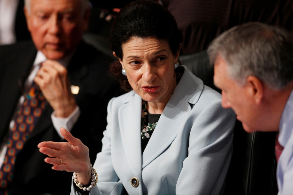 Senate Finance Committee member Sen. Olympia Snowe, R-Maine, center, confers with fellow committee member Sen. Jon Kyl, R-Ariz., as Sen. Orrin Hatch, R-Utah, looks on at left, during the committee's hearing regarding health care reform, Tuesday, Oct. 13, 2009, on Capitol Hill in Washington. (AP Photo/Charles Dharapak)