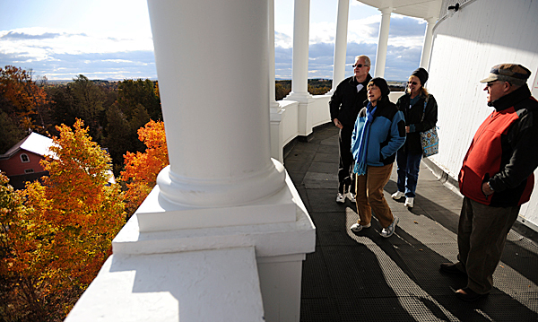 Jim Esuleman, left, and his wife, Marianne, second from right, of Mountain Top Penn. take in the fall colors from the Thomas Hill Standpipe while being guided on Wednesday, October 14, 2009 by friends, Chuck Geyer, right, and his wife Jane of Stuben, second from left. &quotThey are fantasic&quot said Jim Esuleman of the view and colors surround the standpipe. (Bangor Daily News/Kevin Bennett)
