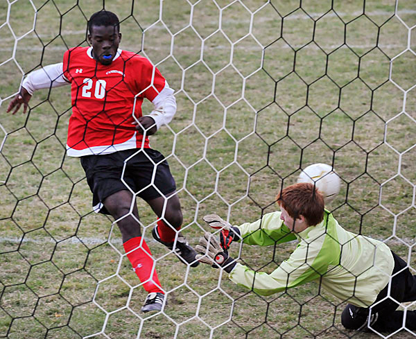 Camden Hills' Jimmy Weferling ,(20), puts  the ball into the net over Mt View keeper Nick Knight in the second half of their game at Mt View, Wed., Oct. 14, 2009.