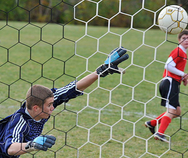 Camden Hills' keeper Ian Cushing is just too late to block a direct kick by Mt View in the first half of their game at Mt View, Wed., Oct. 14, 2009. 