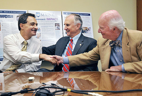 UMaine researcher Habib Dagher, L, UMaine President Robert Kennedy, and Allan  Ferland share enthusiasm as the official announcement of an $8 million dollar grant to the U of Maine for the development of offshore wind-power generation, Thursday, Oct. 15, 2009. Bangor Daily News/Michael C. York