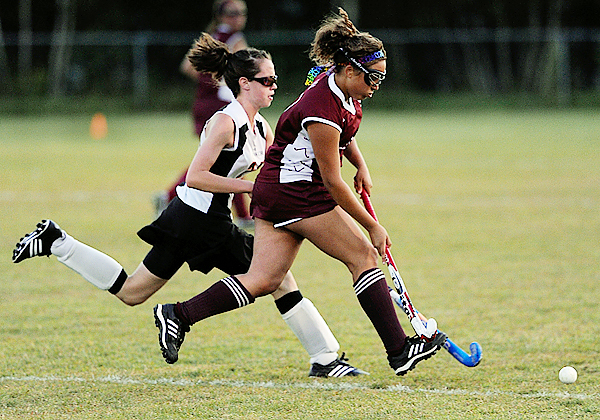 Bangor's Tynesha Dias (right) and Brewer's Lindsay Houp battle for a loose ball during the first half of Tuesday's high school field hockey game in Brewer. The Rams won 4-1. (BANGOR DAILY NEWS PHOTO BY JOHN CLARKE RUSS)  CAPTION  Bangor High's Tynesha Dias,right and  Brewer's Lindsay Houp go after a loose ball in the first half of their match at Brewer High School Tuesday evening, September 8, 2009. (Bangor Daily News/John Clarke Russ)