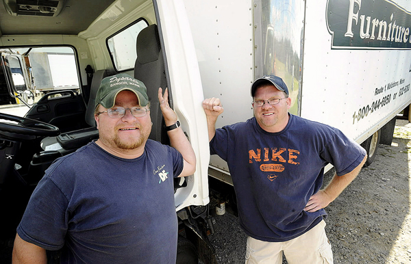 Gary Nisbet (left), 35, and Randy Joubert, 36, work at the Dow Furniture store in Waldoboro on Thursday. Joubert seared the state database in January to find out about his birth parents and was told he had a brother, but was given only a first name for his sibling.He and Nisbet have been working together since July, riding in the same delivery truck, unaware that they were brothers. Eventually Joubert asked Nisbet about his birthday and parents after many of the store customers commented that they looked like brothers.  (BANGOR DAILY NEWS PHOTO BY GABOR DEGRE)