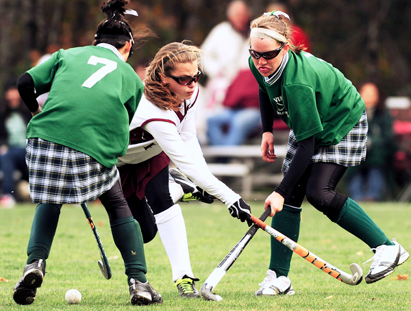 Bangor's Dana Libhart, center,  swings and misses the ball while being challenged by Oxford Hills Marissa Higgins, left, and Hannah Warren, right. Bangor won 1-0. (Bangor Daily News/Kevin Bennett)