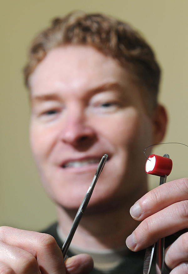 Todd O'Brien, a Lincoln podiatrist shows off his latest invention called, SutureSafe. The device allows a surgeon to safely rest a needle while performing other tasks during surgery. (Bangor Daily News/Kevin Bennett)