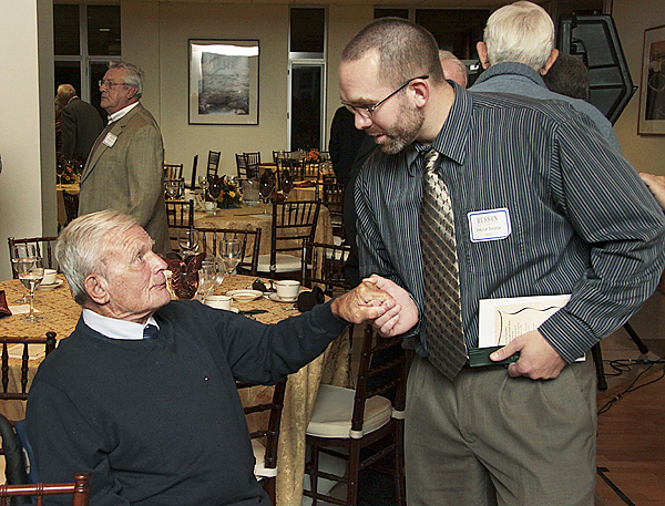 David Dostie, 29, of Sabattus (right) congratulates his former baseball coach John Winkin, 90, at an alumni dinner Saturday at Husson University in Bangor. Winkin was inducted into the school's Sports Hall of Fame. &quotHe's very special to me,&quot Drostie said of Winkin, who suffered a stroke last year. &quotCoach is someone I'll always look up to.&quot (Photo courtesy of Larry Ayotte)