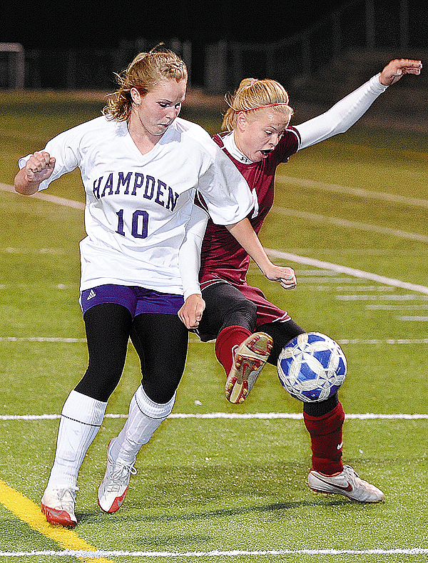 Bangor High School's Kim Jordan (right) battles for the ball with Hampden Academy's Ashley Danforth during the first half of the game in Hampden Tuesday evening. (Bangor Daily News/Gabor Degre)