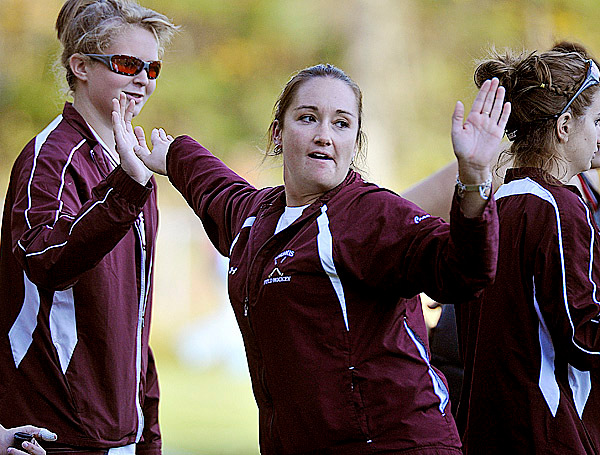 Nokomis field hockey coach Katie Thompson high-fives her players after winning their game versus Mt. View Wed., Oct. 21, 2009. Bangor Daily NEws/Michael C. York