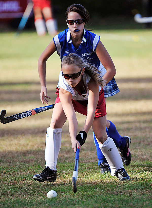 Dexter Tiger Whitney Mower, (5), tries to bring the ball out of the defensive zone away from Stearn's Shannon Murchison, (48), in the first half fof their game in Dexter, Wed., Oct. 21, 2009. Bangor Daily NEws/Michael C. York