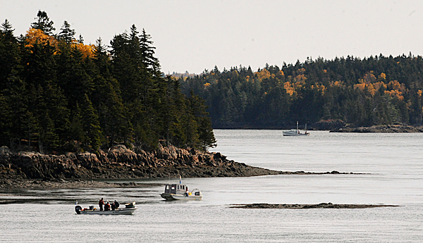 Urchin fishing boats work on Cobscook Bay near the reversing falls Wednesday, Oct. 21, 2009.  Three fishermen, who were on an urchin boat, were reported missing Tuesday evening, which sparked a search by U.S. and Canadian rescue personnel, Maine Marine Patrol, Maine State Police and local fishermen.  The body of one of the fishermen was found Wednesday afternoon. (Bangor Daily News/Gabor Degre)