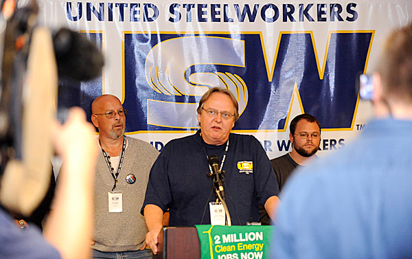 Emery Deabay (center), Maine U.S.W. secretary Local 1188, was one of the speakers during Wednesday's press conference in Bangor to urge U.S. Senators Snowe and Collins to pass strong clean energy legislation. Behind him are Dan Lawson  (left, Maine Labor Council Trustee/U.S.W.  Local 1188) and an unidentified participant. (Bangor Daily News/John Clarke Russ)