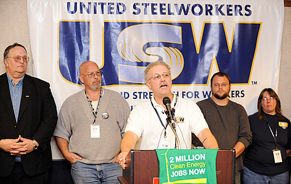 Ron Hemingway, center, a veteran organizer and vice president of the Maine Labor Council and an officer at NewPage paper mill in Rumford, was one of the speakers during Wednesday's press conference in Bangor to urge U.S. Senators Snowe and Collins to pass strong clean energy legislation. Behind him (left to right) are Duane Lugdon of United Steelworkers International, Dan Lawson (of U.S.W. Local 1188 and a M.L.C. trustee), and two unidentified participants. (Bangor Daily News/John Clarke Russ)