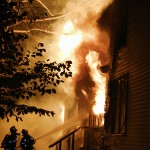 Garage fire melts siding on nearby homes