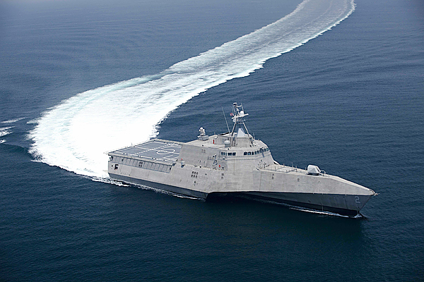 This image provided by the US Navy shows the littoral combat ship Independence (LCS 2) underway during builder's trials on July 12, 2009. Builder's trials are the first opportunity for the shipbuilder and the U.S. Navy to operate the ship underway, and provide an opportunity to test and correct issues before acceptance trials. The second of the Navy's new generation of speedy warships designed to operate close to shore topped 50 miles per hour in builder trials completed this month. Officials say the Independence, a 418-foot ship built in Alabama, traveled in excess of 45 knots, which equates to nearly 52 mph, and sustained 44 knots during a four-hour, full-speed sprint. (AP Photo/Dennis Griggs - US Navy)