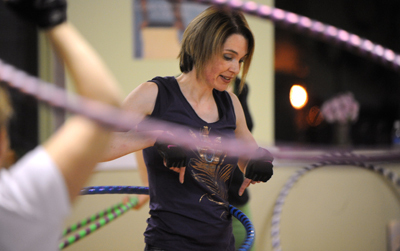 Jenny Carr, hooping instructor and teacher, during one of her fitness classes in Bangor that involves lots of hula hooping.  Carr teaches hooping, dance and fitness, and also makes hula hoops. Buy Photo