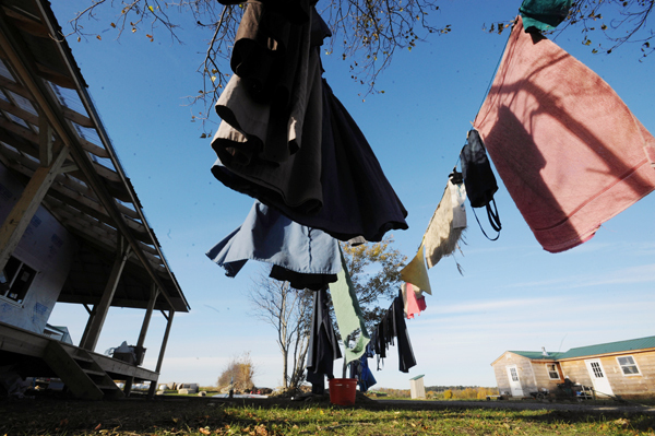 The laundry is drying in the afternoon sun at the Zimmerman family's produce and dairy farm in Thorndike Friday.  They moved to the area in May of 2009 and are members of the growing Amish community in the Unity and Thorndike area.  Ivan Zimmerman is known in the community as a man who is good at fixing machines.  He even keeps an old steam engine in operating condition to power farm equipment.  (Bangor Daily News/Gabor Degre) (Bangor Daily News/Gabor Degre)
