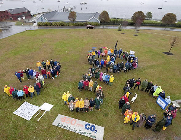 Participants in a climate change rally in Belfast Saturday, Oct. 24, 2009 formed themselves in the shape of the number &quot350&quot in reference to their call for bringing the number of carbon dioxide particles in our atmosphere to 350 parts per million. Some scientists say that's a level of carbon dioxide under which climate change can be slowed or stopped. Earth currently has about 378 parts per million of carbon dioxide in its atmosphere. (PHOTO COURTESY OF GEORGES NASHAN)