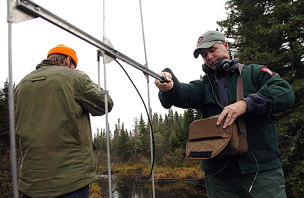 (BANGOR DAILY NEWS PHOTO BY BRIDGET BROWN)  CAPTION  Department of Inland Fisheries and Wildlife biologist Tim Obrey (right) uses a radio antenna to listen for brook trout that have been tagged as Piscatiquis County Commissioner Eric Ward (left) scans the Socatean Stream for the fish on Tuesday, Oct. 13, 2009. The Socatean is one of several streams flowing into Moosehead Lake which the species swims upriver to spawn in fall months. &quotThis is it,&quot said Obrey. &quotWe are the last place on the East Coast [with brook trout],&quot referring to northern parts of Maine. (Bangor Daily News/Bridget Brown)