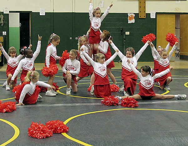 A youth cheering team from the Pittsfield area strikes its final pose Saturday, Oct. 24, 2009 during an exposition to cap off the recently-ended youth sports season. The program, which began four years ago, attracted more than 60 participants this year. (BANGOR DAILY NEWS PHOTO BY CHRISTOPHER COUSINS)