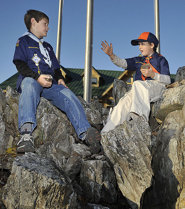 &quotJust being boy's&quot said Daniel Lefton, right  as he and fellow cubscout Kyle Reardon, both of Pack 11, Brewer, scoured the rocks outside the new mess hall at Camp Roosevelt waiting for the dinner to start. Scouts past and present met at the camp to celebrate the 100 years of scouting in the Brewer area. (Bangor Daily News/Michael C. York)