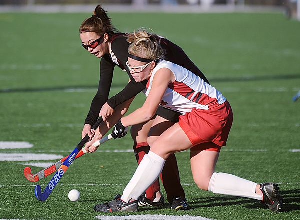 Foxcroft Academy's Jen Seavey (left) and Dexter High School's Katie Eastman battle for the ball during the first half of the Eastern Maine Class C championship game in Hampden Monday afternoon. Dexter won the game 2-1. (Bangor Daily news/Gabor Degre)