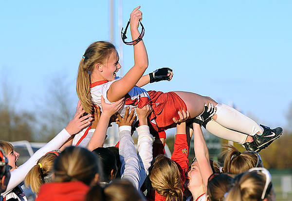 Dexter High School's Whitney Mower is lifted into the air as the team celebates their victory over Foxcroft Academy in the Eastern Maine Class C championship game in Hampden Monday afternoon.  Mower scored both of Dexter's goals to win the game 2-1. (Bangor Daily news/Gabor Degre)