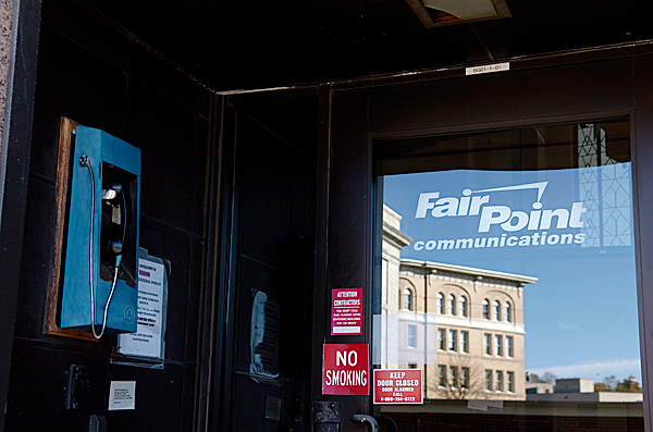 (BANGOR DAILY NEWS PHOTO BY BRIDGET BROWN)    CAPTION    FairPoint Communications' Bangor office entrance is seen in this photo taken Monday, Oct. 26, 2009, the day the company announced its filing for voluntary Chapter 11 bankruptcy. FairPoint owns and operates phone companies in 18 states, though its largest holdings are in Maine, New Hampshire and Vermont, where it bought Verizon Communications Inc.'s land lines and Internet network for $2.3 billion in 2008. (Bangor Daily News/Bridget Brown)