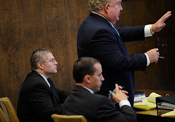 Defendant Ryan Witmer,far left, of Eddington listens to his counsel, Portland attorney Daniel Lilley (cq) (standing), address the bench before the jury was seated for opening arguments at Penobscot Superior Court in Bangor Monday afternoon, October 26, 2009. Witmer was charged with trying to kill his estranged wife and her male friend in the summer of 2008. In the foreground is defense co-counsel, Portland attorney Darrick Banda (cq). (Bangor Daily News/John Clarke Russ)