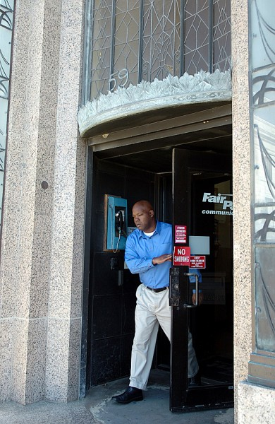(BANGOR DAILY NEWS PHOTO BY BRIDGET BROWN)    CAPTION    A FairPoint Communications employee exits the Bangor offices in this photo taken Monday, Oct. 26, 2009, the day the company announced its filing for voluntary Chapter 11 bankruptcy. FairPoint owns and operates phone companies in 18 states, though its largest holdings are in Maine, New Hampshire and Vermont, where it bought Verizon Communications Inc.'s land lines and Internet network for $2.3 billion in 2008. (Bangor Daily News/Bridget Brown)