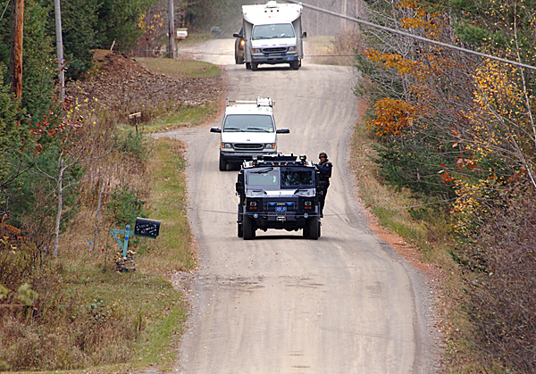 A craavan of State Police tactical team vehicles travel on the Rutland Road in Newport as a massive manhunt continued through the day Tuesday, Oct. 27, 2009 for Perley Goodrich Jr, who allegedly shot and kiilled his father Monday night (Bangor Daily News photo by Scott Haskell)