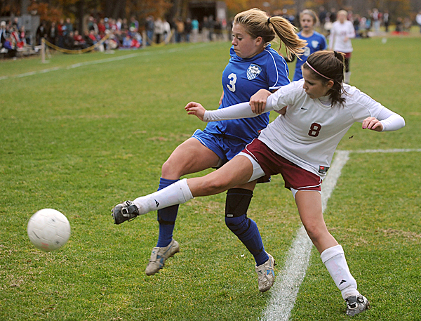 Bangor High School's Eliza Estabrok (right) battles for the ball with Morse High School's Emily Howell during the first half of the Class A quarterfinal game in Bangor Tuesday evening.   (Bangor Daily News/Gabor Degre)