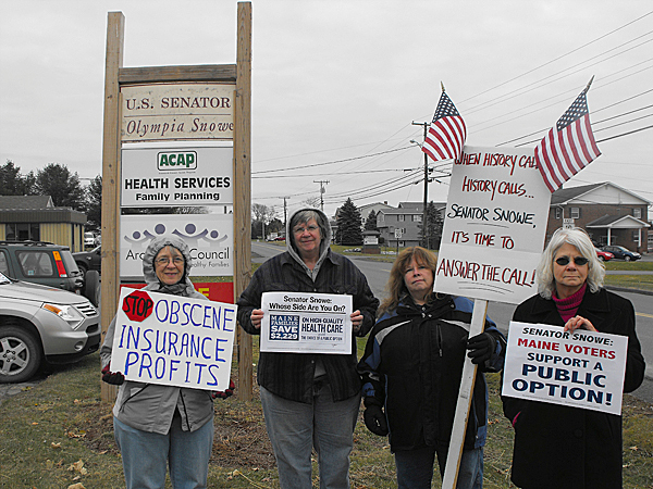 MoveOn members (from left,) Alice Bolstridge, Linda Griffith, Joanne Young and Michele Green gathered in front of U.S. Sen. Olympia Snowe's Presque Isle office to urge her to support national health care reform legislation with a public heath insurance option. MoveOn members from across the state held press conferences outside of Snowe's six Maine offices during the day to release a new report that members say clearly lays out the economic benefits of health care reform with a public option to Maine residents. (BANGOR DAILY NEWS PHOTO BY JEN LYNDS)
