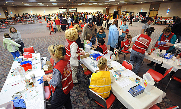 At least 50 nurses from several public health organizations were giving flu shots during a mass vaccination at the Bangor Auditorium Wedesday morning. About 4000 doses of H1N1 and the same number of seasonal influenza vaccine doses were available in Bangor. (Bangor Daily News/Gabor Degre)