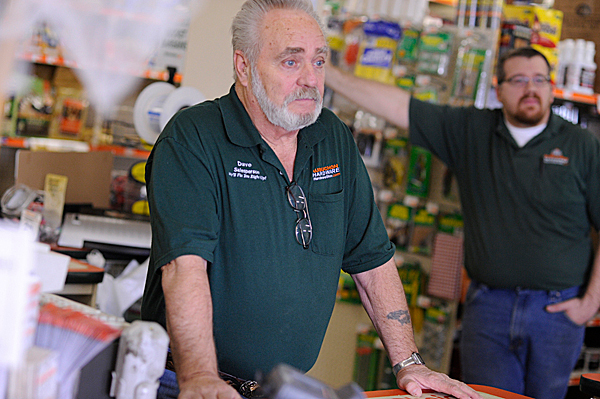 Dave Brown of Corinna, a saleperson at Aubuchon Hardware in Newport, talks with the BDN Wednesday about the town's reaction to Monday night's homicide at the Goodrich family's home on the Rutland Road. &quot I think when they find him [suspect Perley Goodrich Jr.], he's going to be dead. It's just a gut feeling.&quot In the background of the photo is store manager Pete Biron (CQ) of Bangor. (Bangor Daily News/John Clarke Russ)