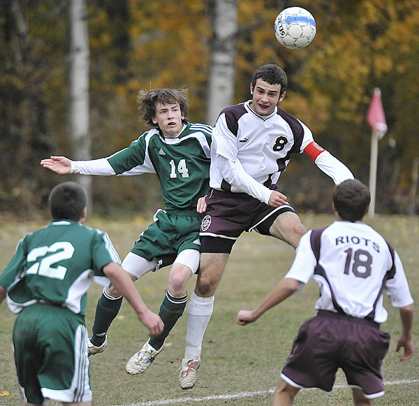 Holwer Robin Buttery, (14), collides with Riots' Sean Kilpatrick, (8), after heading the ball out of the defensive zone in the first half of their game in Orono, Wed., Oct. 28, 2009. Bangor Daily News/Michael C. York
