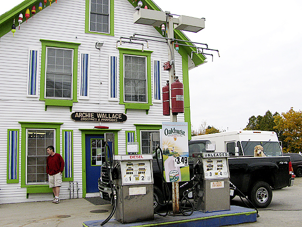 FRIENDSHIP -- Lobster buoys from local fisherman hang from the eaves of the colorful Archie Wallace store. When lobster prices plummeted last year, the store's fortunes fell, too, said co-owner Ernie Coletti.(Bangor Daily News photo by Abigail Curtis)