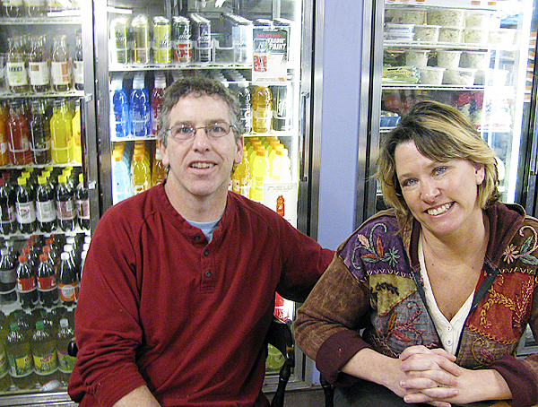 FRIENDSHIP -- &quotIt's something we feel we need in order to stay in business,&quot Ernie Coletti said Thursday about the possibility of selling beer and wine in the fishing village which has been dry at least since the Prohibition. He and his wife, Joan Coletti, have owned the Archie Wallace store for six years and say that times have been tough but alcohol sales would help. (Bangor Daily News photo by Abigail Curtis) FRIENDSHIP -- Ernie and Joan Coletti sit at the table in front of their soda and dairy cooler. &quotSome days we feel really optimistic,&quot Joan Coletti said about the chance that the dry town may vote next week to allow sales of beer and wine. &quotSome days we just feel worried.&quot (Bangor Daily News photo by Abigail Curtis)