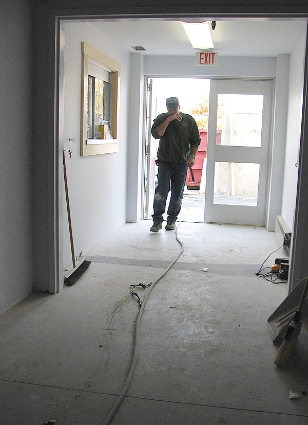 Plumber Jim Miller of West Enfield walks into the new Southwest Harbor Police Station on Wednesday after moving materials outside. The police station expansion and renovation of the first floor of the municipal building is expected to completed around mid-November, according to local officials. (Bangor Daily News photo by Bill Trotter)