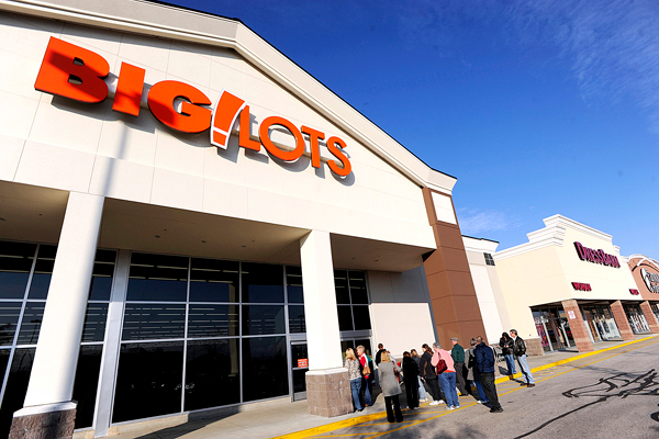 The first customers wait for the doors to slide open for Friday morning's grand opening of the new  Big Lots discount store at the Bangor Parkade  Shopping Center. BANGOR DAILY NEWS PHOTO BY JOHN CLARKE RUSS