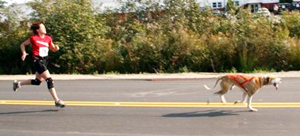 Christina Eagle, runs cross country with her dog. PHOTO COURTESY OF CHRISTINA EAGLE