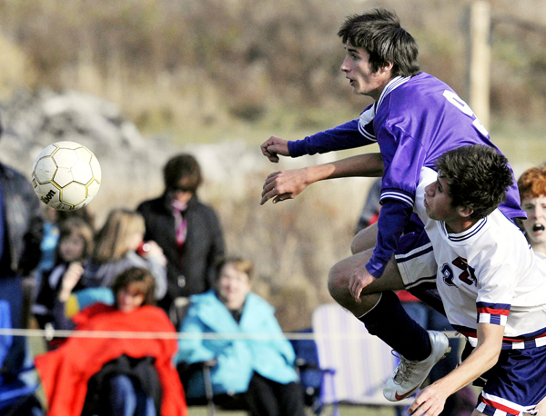 Bangor Christian's Zach Sirois, (9), and Southern Aroostook's Anthony Diaferio, (9), contend for the ball in the first half of their game in Bangor, Friday, Oct. 30, 2009. Bangor Daily News/Michael C. York
