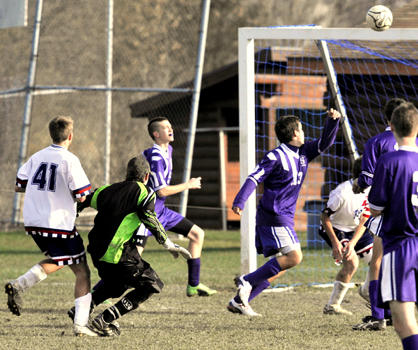 Bangor Christian's Christopher Parent, (41), and Southern Aroostook's keeper Jesse Boulier watch as Parent's chip shot goes under the crossbar to give the BC Patriots the first goal of their game in Bangor, Friday, Oct. 30, 2009. Bangor Daily News/Michael C. York