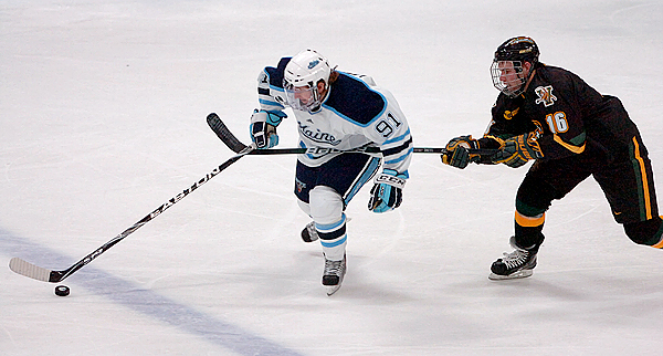 University of Maine's Klas Leidermark (91) tries to fend off the University of Vermont's Jay Anctil (16) who was penalized for hooking in the second period of Friday's game, Oct. 30, 2009 at the Alfond Arena in Orono. (Bangor Daily News/Bridget Brown)