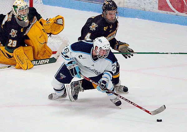 University of Maine's Adam Shemansky maintains control of the puck in front of the University of Vermont's Patrick Cullity as goaltender Rob Madore awaits the outcome in the first period of Friday's game, Oct. 30, 2009 at the Alfond Arena in Orono. (Bangor Daily News/Bridget Brown)