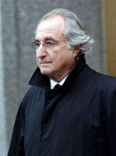 FILE - In this Jan. 14, 2009 file photo, Bernard L. Madoff leaves Federal Court in New York. The trustee overseeing the liquidation of Bernard Madoff's assets on Wednesday, Oct. 28, 2009 said more than $530 million has been paid so far to victims of the disgraced financier's massive fraud. (AP Photo/Stuart Ramson, file)