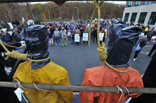 A pair of mannequins dressed in fishing gear with nooses around their necks decorated the stage as hundreds of fishermen rally against new fishing regulations outside the National Oceanic and Atmospheric Administration building in Gloucester, Mass., Friday, Oct. 29, 2009. (AP Photo/Josh Reynolds)
